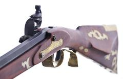 Close Up View Of The Flint Lock Mechanisim On A Replica Rifle - stock photo