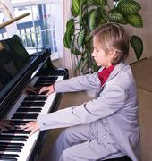Young Man Preparing For A Recital - stock photo