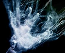 hand smoke blue - stock photo