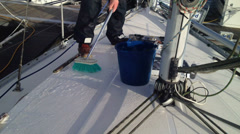 Scrubbing yacht decks with brush Stock Footage