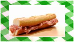 Sandwiches edited sequence over green tablecloth background Stock Footage