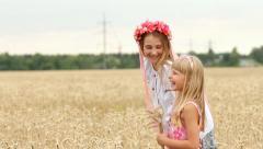 Two Happy Ukrainian Kid Girls Laughing in Wheat Field HD Stock Footage