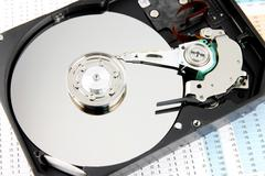 Hard drive open the top cover off on business graph. Stock Photos