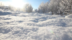 Soft white friable snow in a sunny weather on a meadow Stock Footage