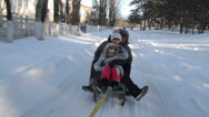 Stock Video Footage of family sledding in the woods
