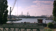 Stock Video Footage of General view of the the port of Hamburg, Bridge in the backdrop