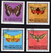 postage stamps showing several types of butterflies - stock photo