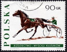 Postage stamp showing jockey and horse pulling a sulky Stock Photos