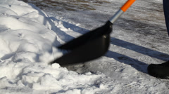 Man with a snow shovel on the sidewalk episode 1 - stock footage
