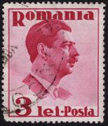 romanian postage stamp showing the portrait of king carol - stock photo