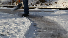 Man with a snow shovel on the sidewalk episode 3 Stock Footage