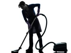 Woman maid housework vacuum cleaner silhouette Stock Photos
