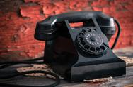Stock Photo of classic black dial-up rotary telephone