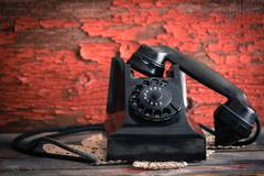Old-fashioned rotary telephone off the hook Stock Photos