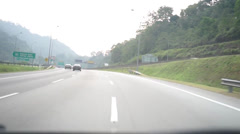 Driving Along Malaysia Highway Into Orange Tunnel Stock Footage