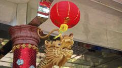 Red Lantern Swinging In Front Of A Dragon Statue Stock Footage