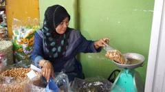 Weighing Up Dried Cashew Nuts In Pengkalan Kubur Market at Kelantan, Malaysia Stock Footage