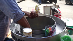 An Asian Man Preparing Famous Baba Ice Cream Under Hot Sunny Day In Malaysia Stock Footage