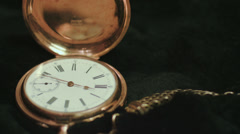 Timelapse of golden vintage antique watches going backwards, with turning camera Stock Footage
