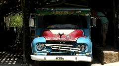 St. Lucia Soufrière area  056 a brightly painted old shabby truck - stock footage