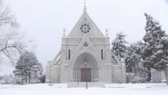 Charming Chapel in Snowstorm Stock Footage