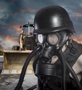 pollution.environmental disaster. post apocalyptic survivor in gas mask - stock photo