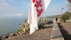 The Jerusalem Flag of the Franciscan Gardens in Capernaum Stock Footage