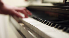 Playing Piano - Hand is blurred, Front Focus Stock Footage