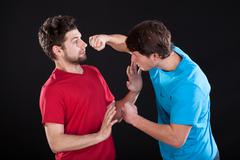 unwanted men's fight - stock photo