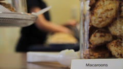 Macaroon Cookies with baker preparing in the background Stock Footage
