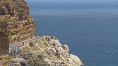 A car driving along Chapman's Peak Drive Stock Footage