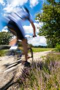 cyclist in blurred motion - stock photo