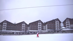 Gondola lift and hotels in ski resort Bansko Stock Footage