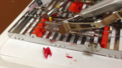 Bloody tooth beside dentist tools. Pulled tooth. Stock Footage
