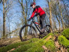 state of the art electric powered mountain bike - stock photo
