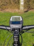 Handlebars of state of the art electric powered mountain bike Stock Photos