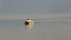 Boat Coming in to Shore on Galilee Stock Footage