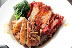 duck meat and pork in white dish. - stock photo