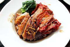 Duck meat and pork in white dish. Stock Photos