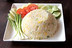 fried rice in white dish on the foods table. - stock photo
