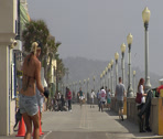 Stock Video Footage of Rollerblader and Pedestrians on the Mission Beach Boardwalk