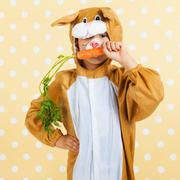 Child as easter hare with carrot Stock Photos