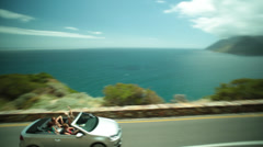 Chapman's Peak Drive as a car drives past Stock Footage