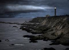 Lighthouse at a storm - stock photo