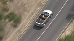 A cabriolet driving along Chapman's Peak Drive Stock Footage