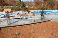 Stock Photo of motion blur composite of skateboarders enjoying new skateboard park