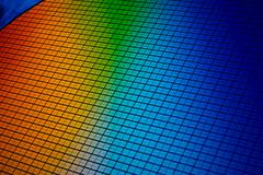 Si wafer, detail of a silicon chip wafer reflecting different colors Stock Photos
