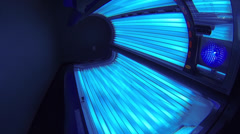 Slow Moving Shot of Powered On Tanning Bed Stock Footage