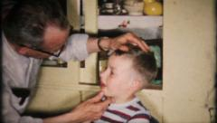 597 - dentist, grandpa pulls tooth with pliers - vintage film home movie - stock footage