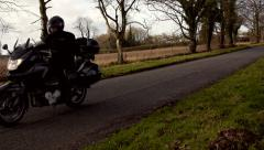 Motorbike passes in slow motion with European hand gesture Stock Footage